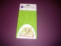 Foremka z kwiatami, listkami i gałązkami